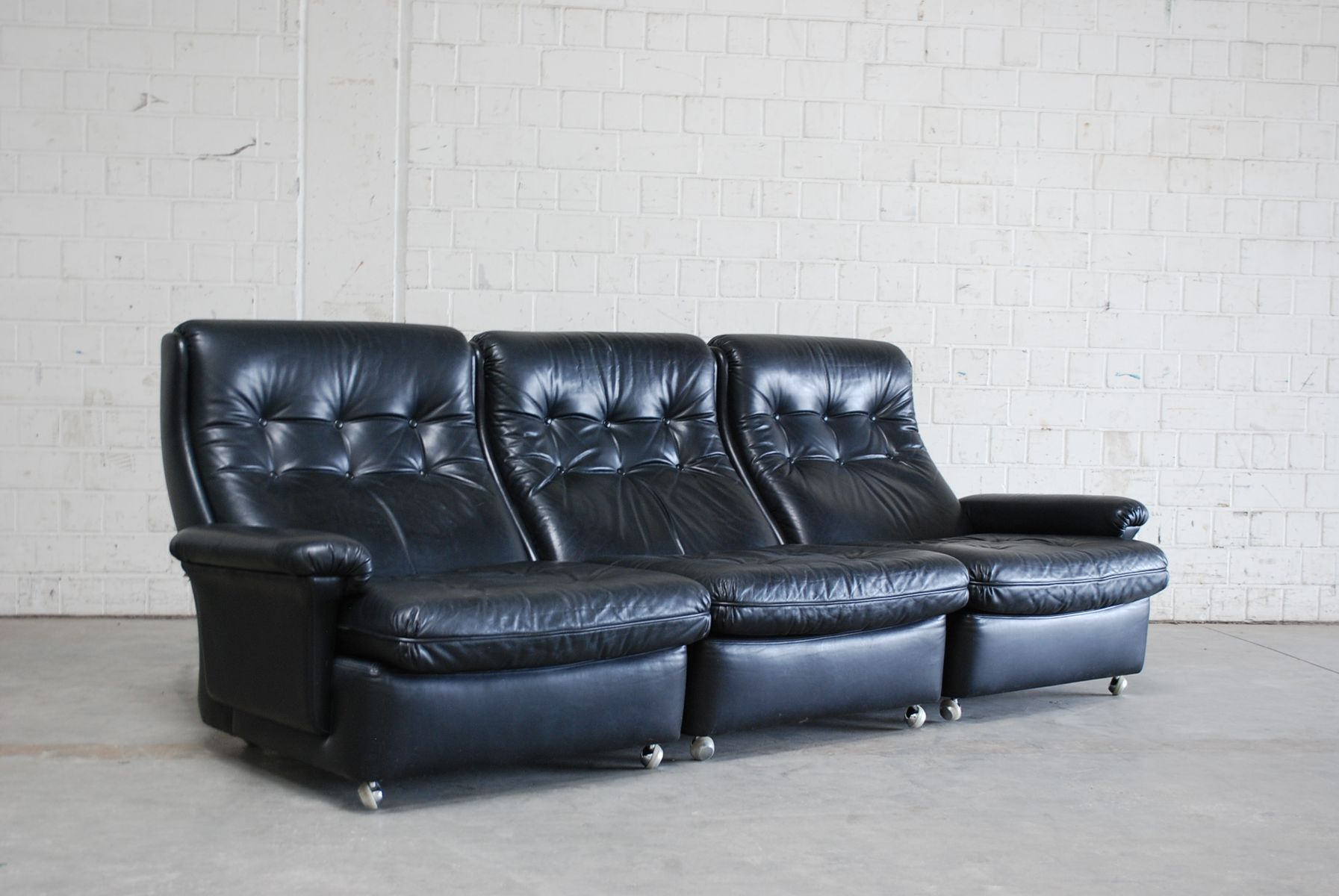 living room suite leather sofa 2 lounge chairs and 2 ottomans from