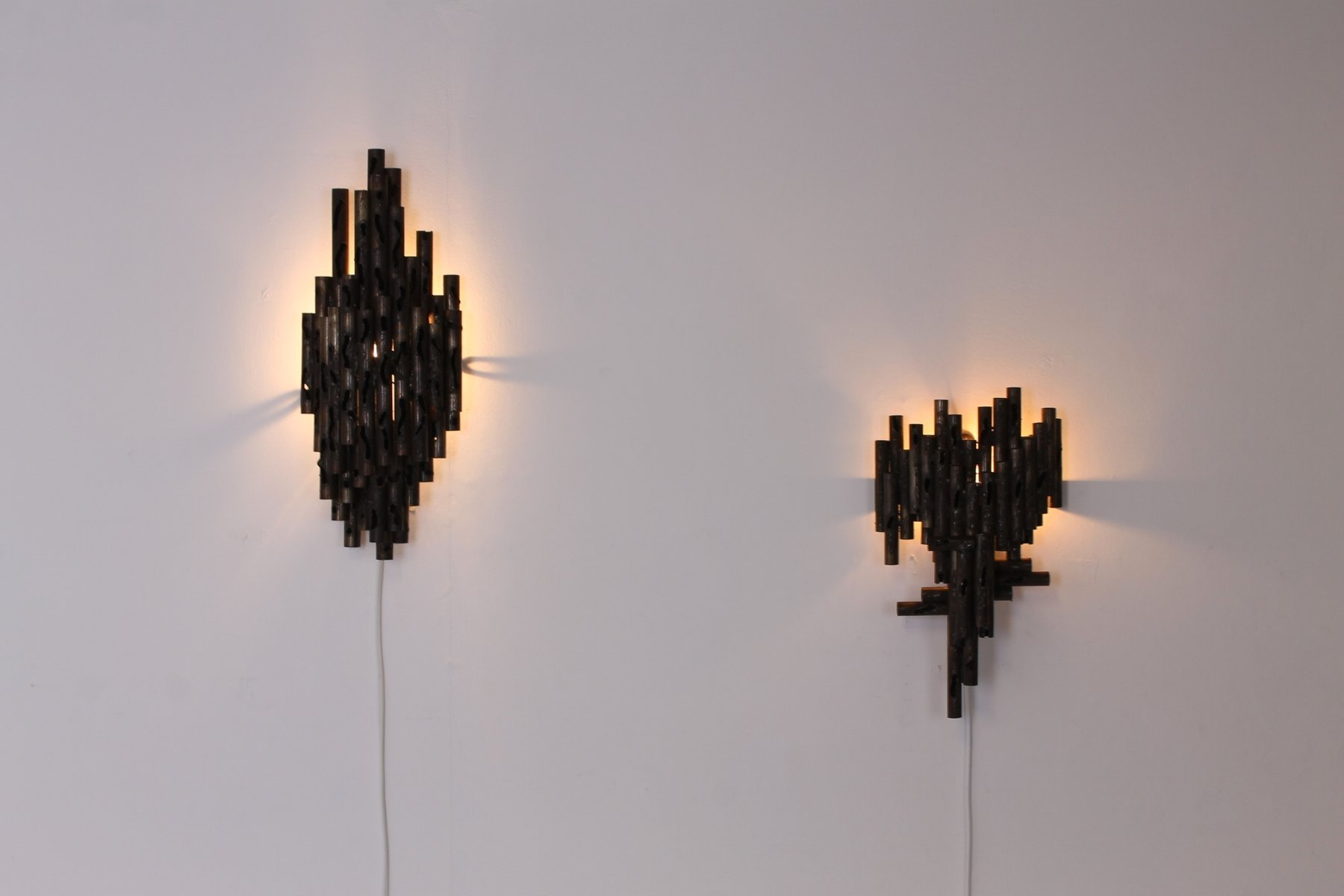 Large Torch Wall Lights : Brutalist Torch Cut Metal Wall Lights by Marcello Fantoni, 1960s, Set of 2 for sale at Pamono