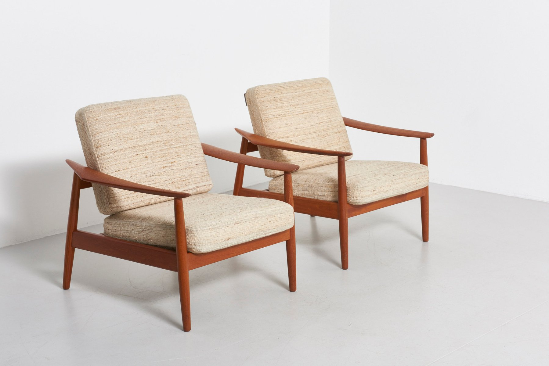 Mid Century Danish Teak Lounge Chairs by Arne Vodder for France