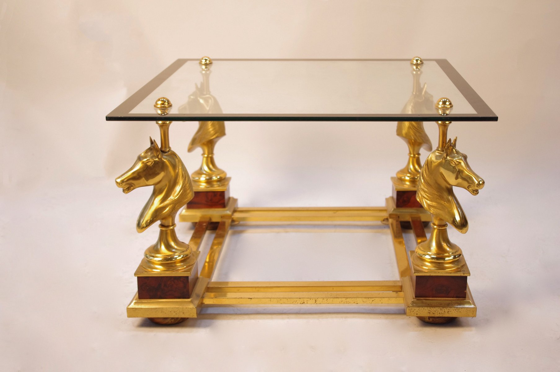 Vintage Gilt Metal And Glass Coffee Table With 4 Horse Busts, 1970s