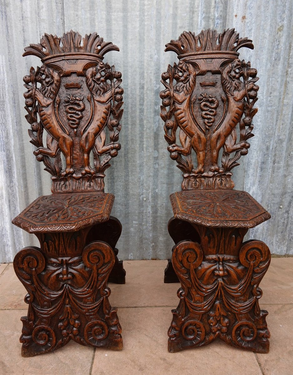 Antique italian chairs - Antique Italian Carved Oak Sgabello Chairs Set Of 2