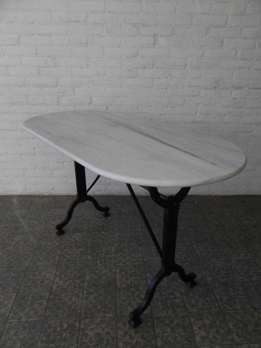 Bistro table with cast iron base and marble top from for Cast iron table base marble top