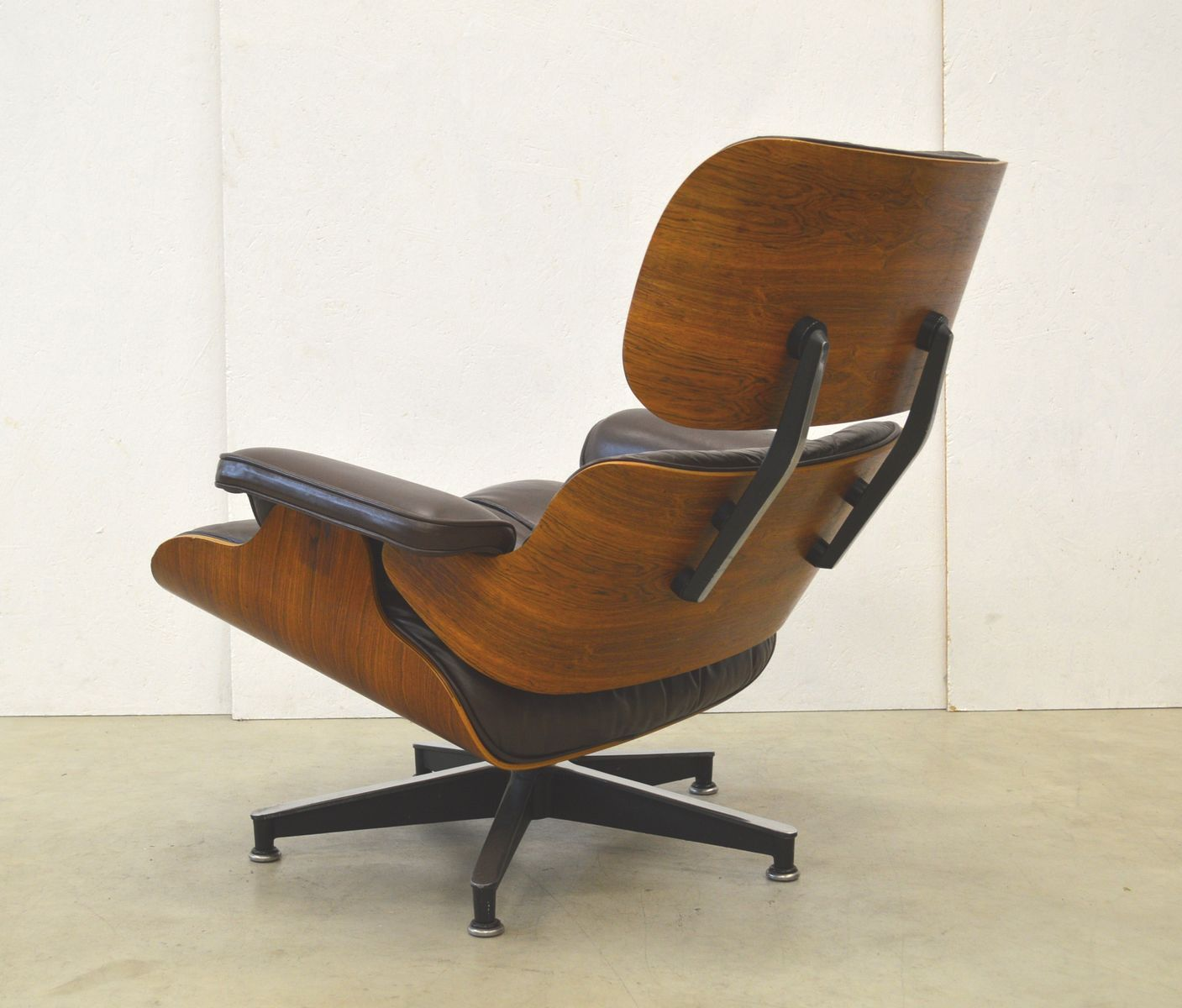 vintage rosewood lounge chair by charles ray eames for herman miller