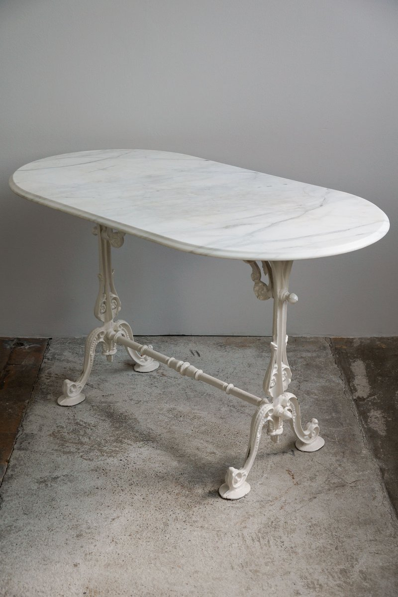 Antique french oval garden table with marble top and cast for Cast iron table base marble top