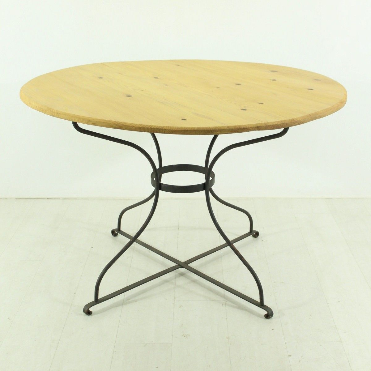 Vintage round dining table with a metal base for sale at Metal table base