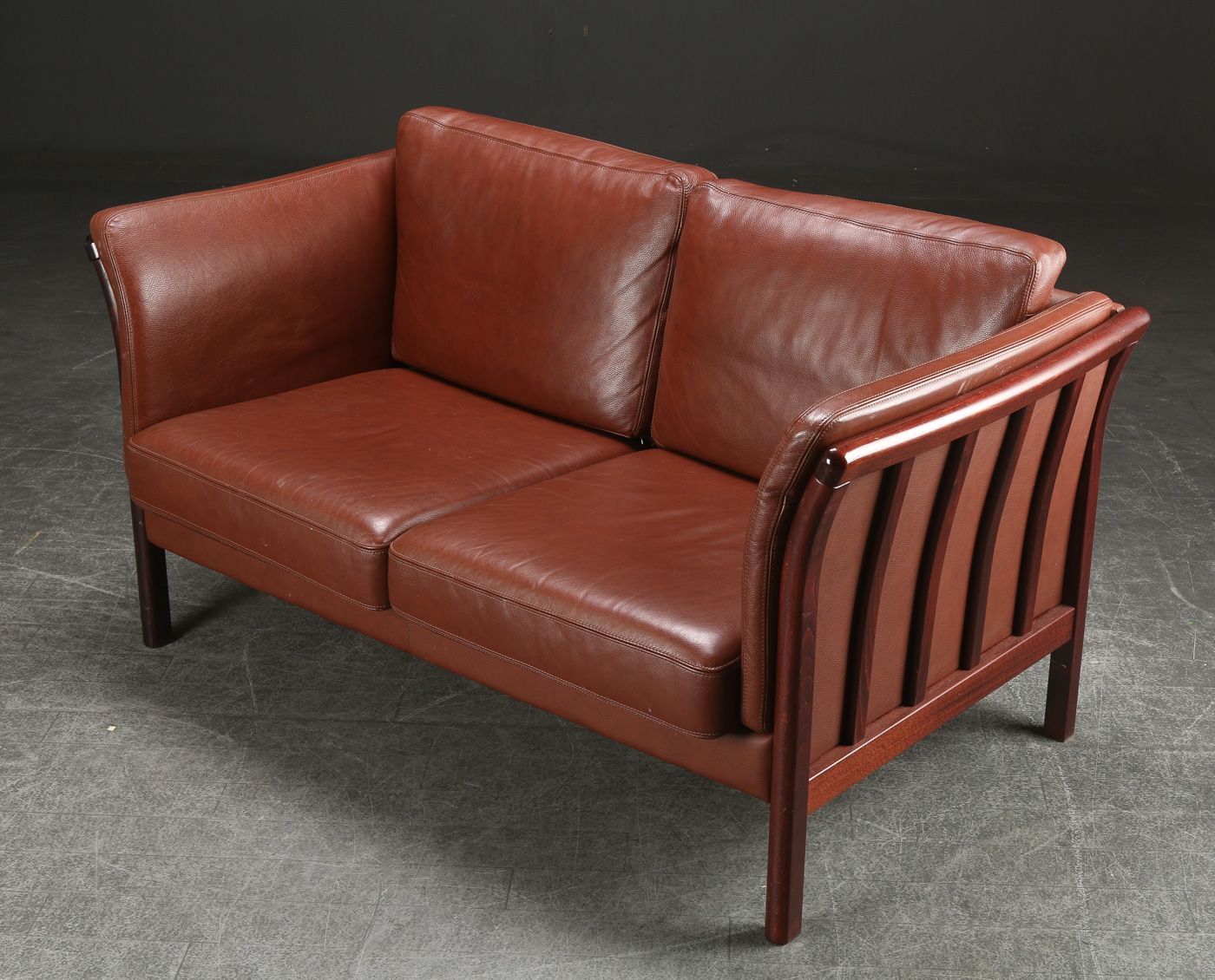 Vintage danish seater leather sofa with wooden frame for