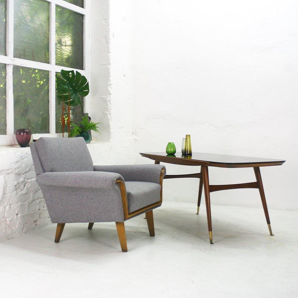 nussholz couchtisch mit schwarzer glasplatte von ilse m bel bei. Black Bedroom Furniture Sets. Home Design Ideas