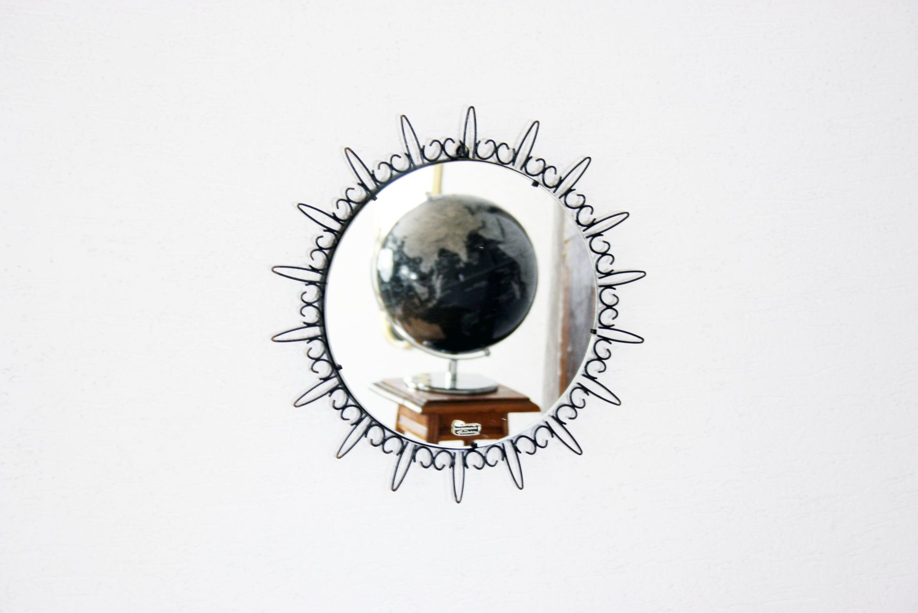black metal sun mirror 1960s