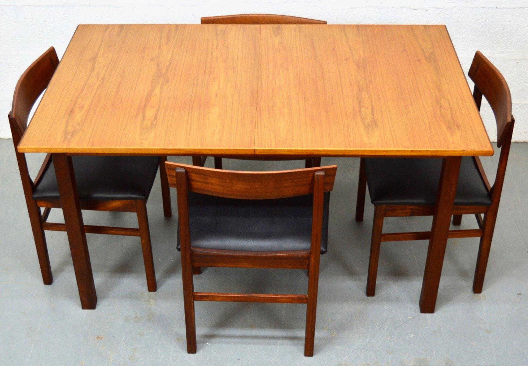 Teakholz tisch  Mid-Century Teak Tisch und Stühle von Gordon Russell bei Pamono kaufen