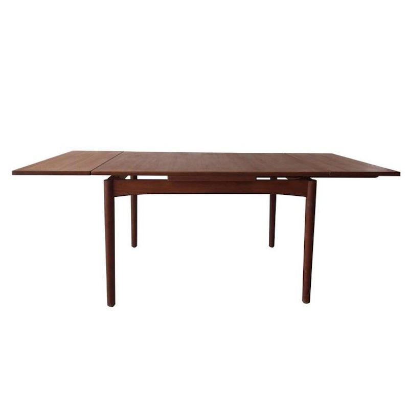 mid century teak dining table with two extension leaves for sale at