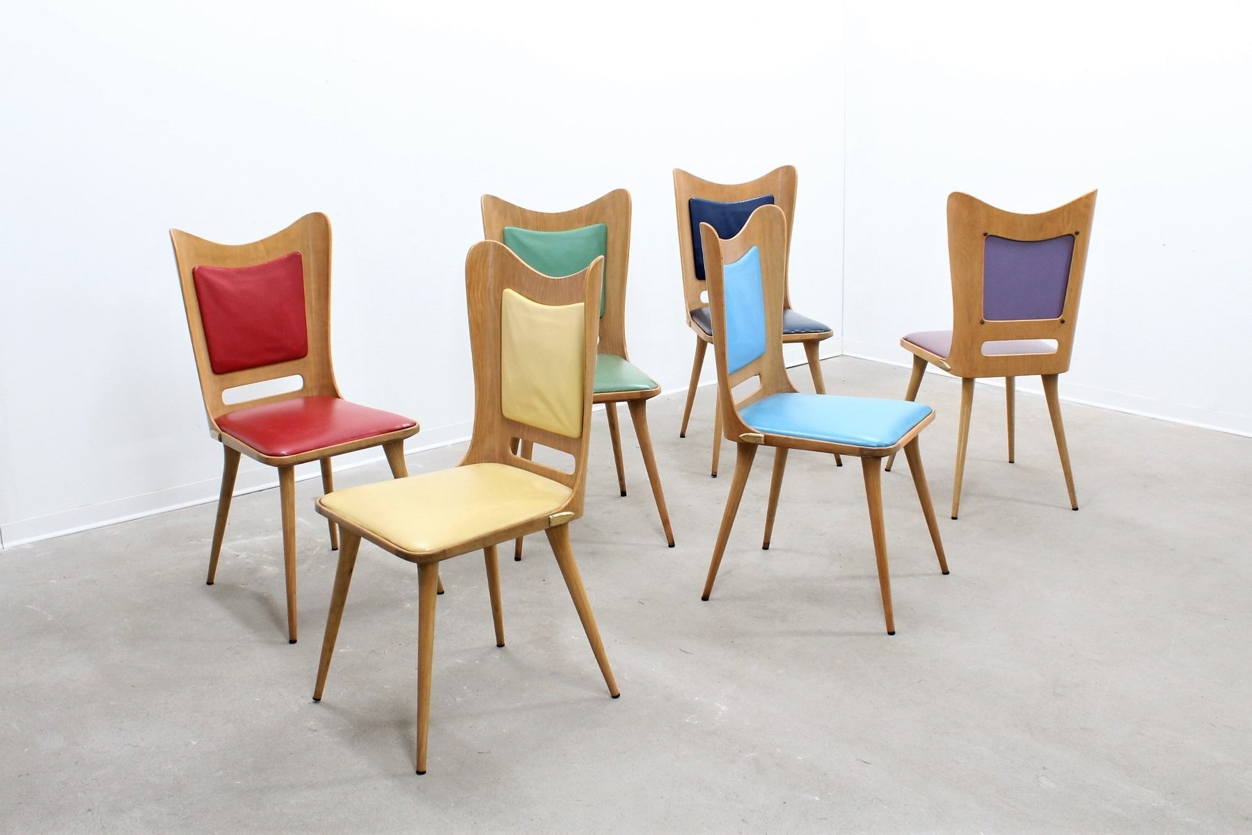 Mid century multi colored dining chairs by carlo ratti for Colorful dining chairs
