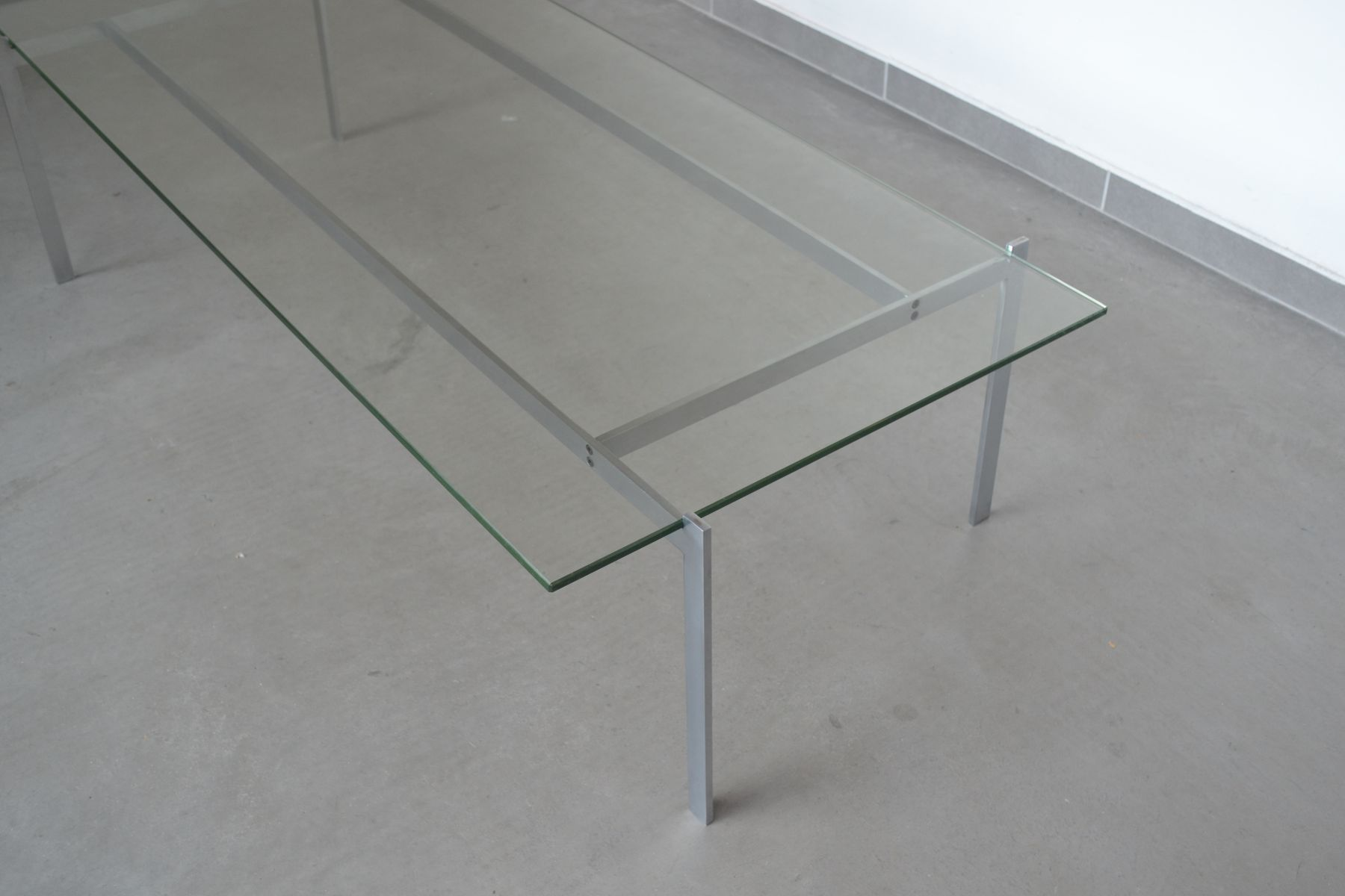 minimalist steel and glass rectangular coffee table 1960s