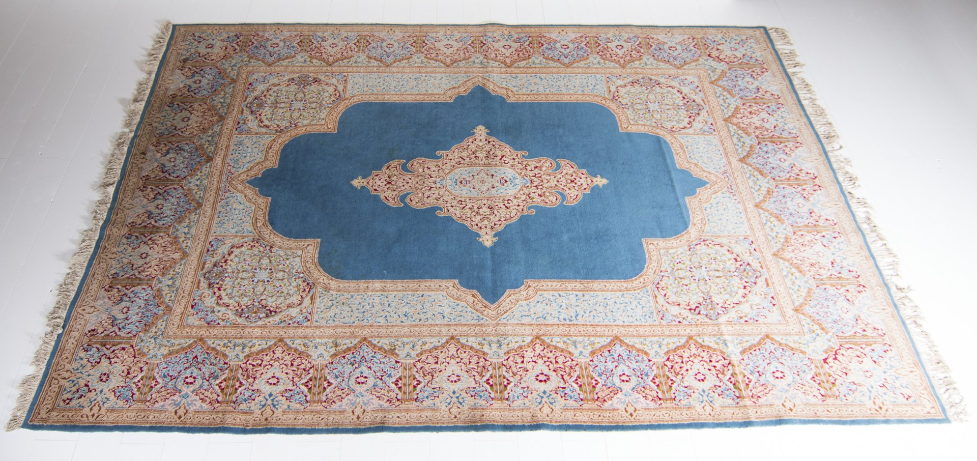 large vintage persian carpet in blue red pink and beige