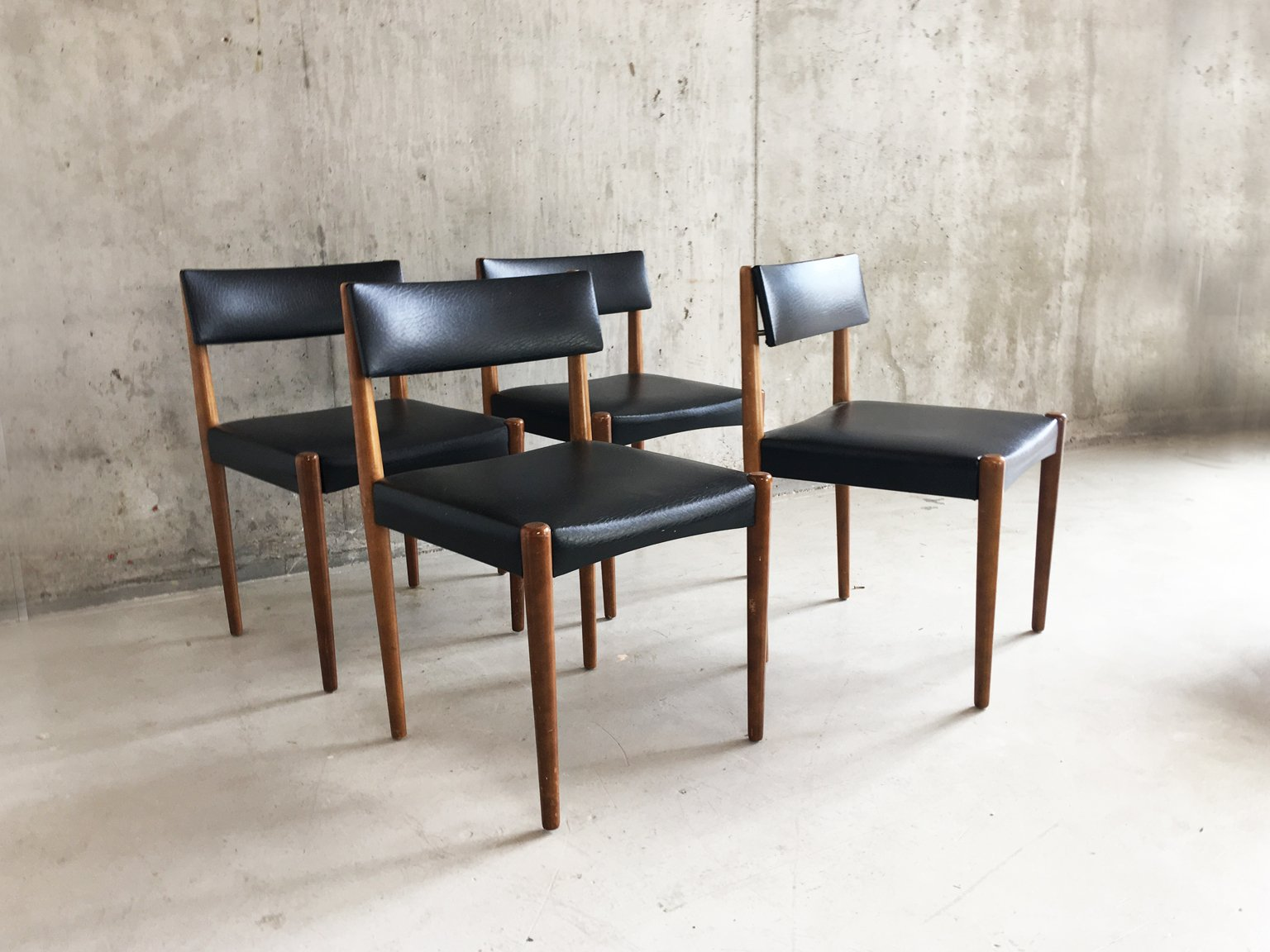 Mid Century Teak And Black Vinyl Dining Chairs 1970s Set