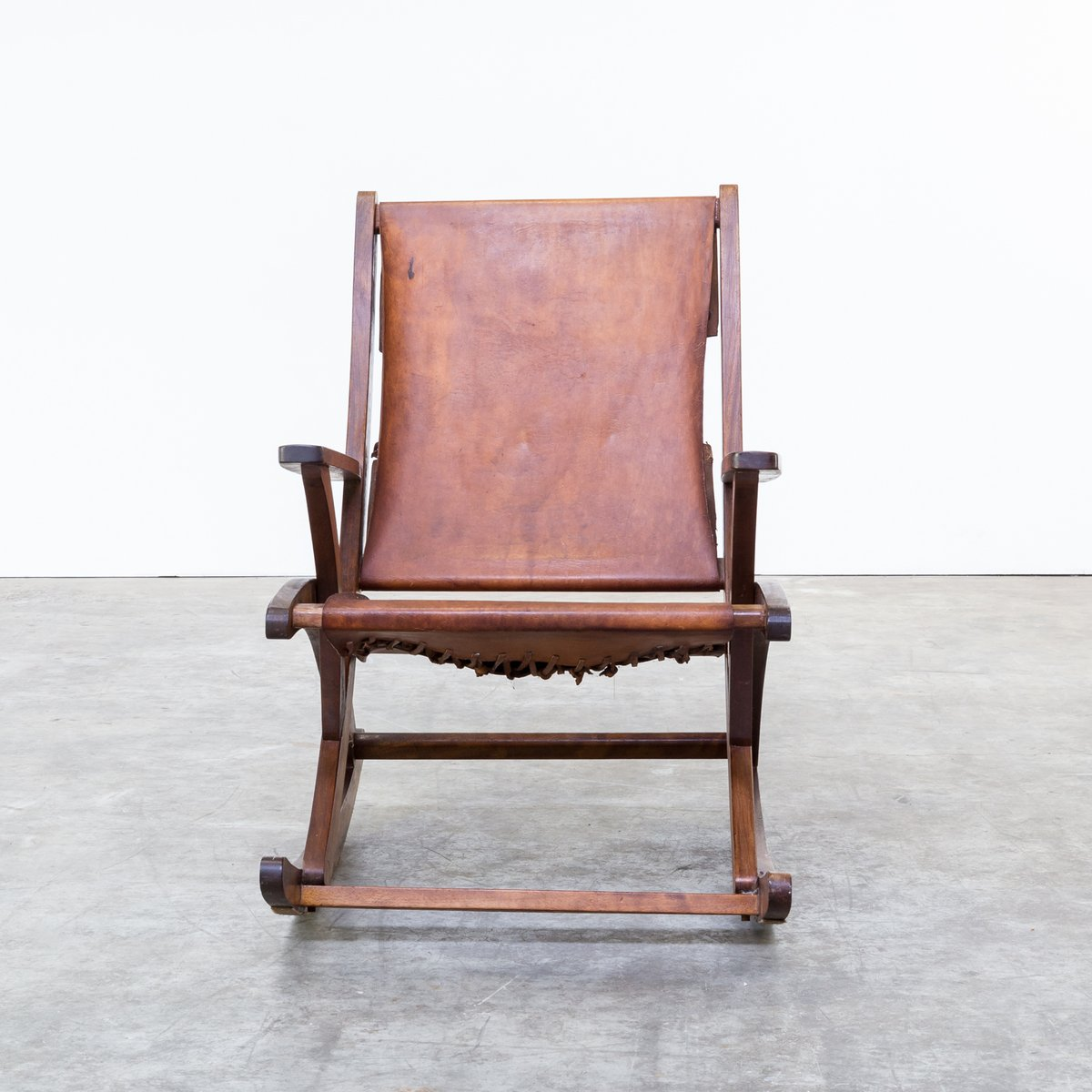 Mid century oak and saddle leather rocking chair for sale