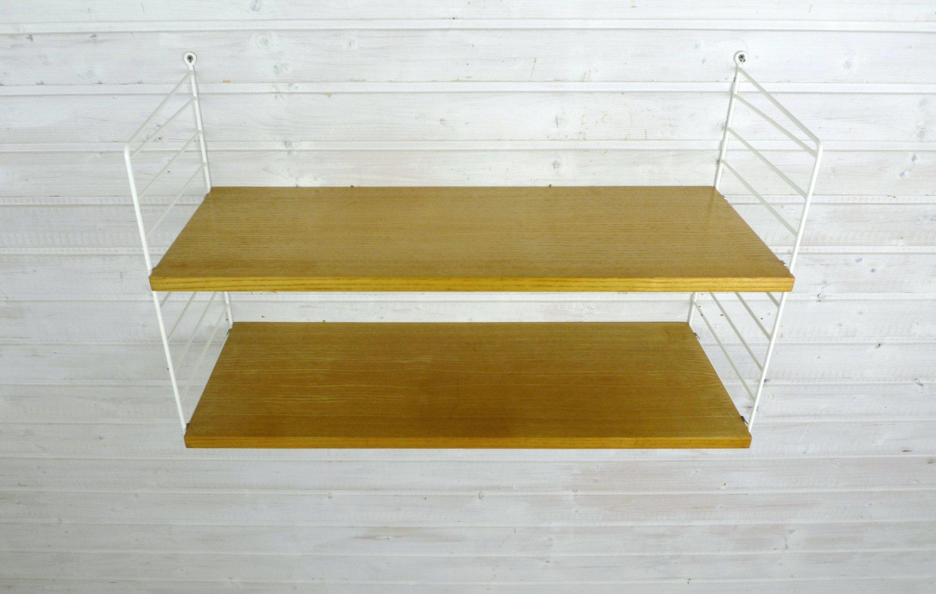 Wandregalsystem design  Wand Regalsystem aus Esche von Nisse Strinning für String Design ...