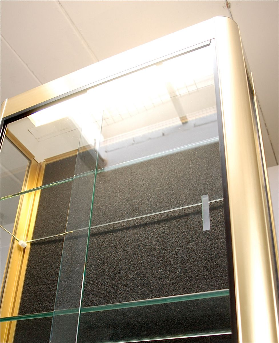 Gold wall display cabinet with sliding glass doors 1970s for Sliding doors for sale