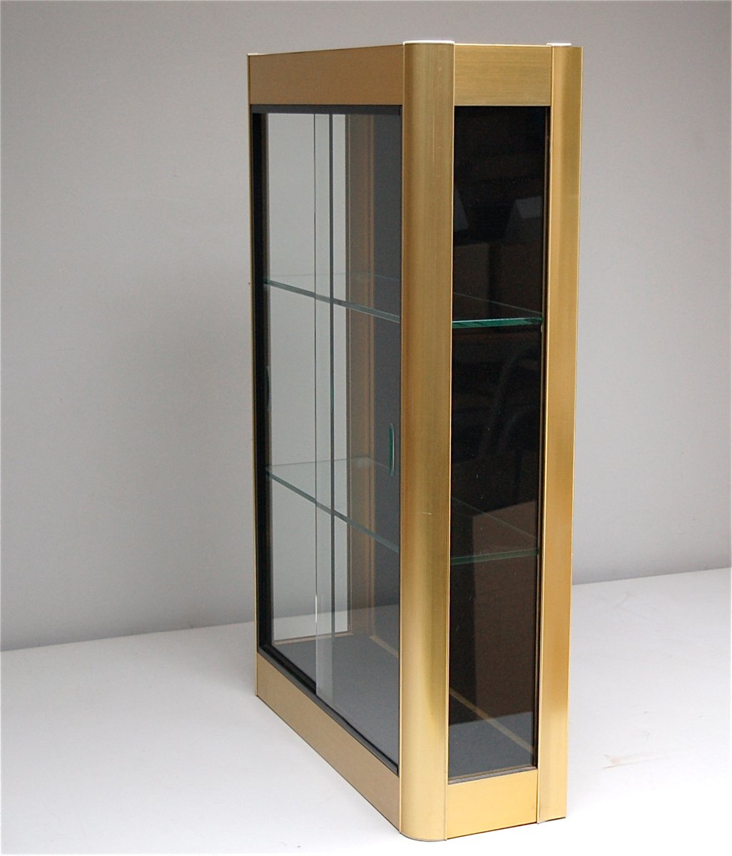 Gold wall display cabinet with sliding glass doors 1970s Glass cabinet doors
