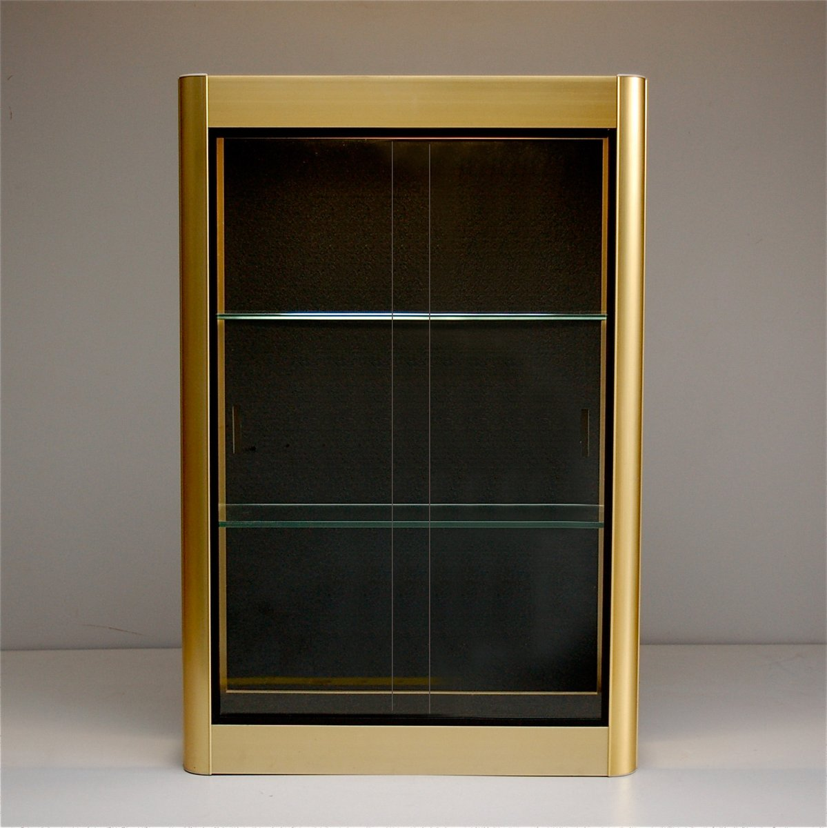 Gold wall display cabinet with sliding glass doors 1970s for Sliding glass doors germany