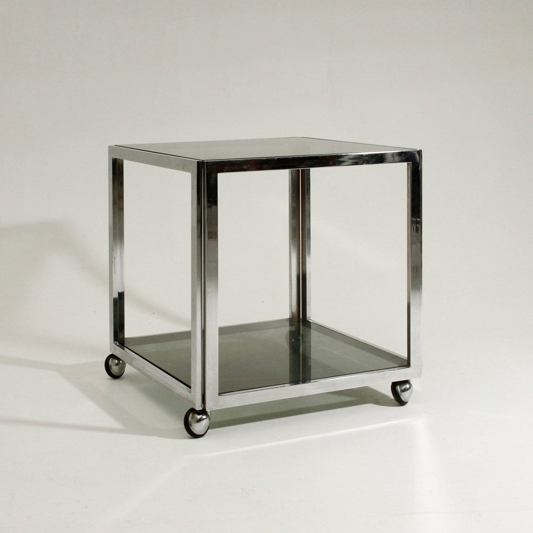 vintage chromed metal side table on wheels 1970s 1