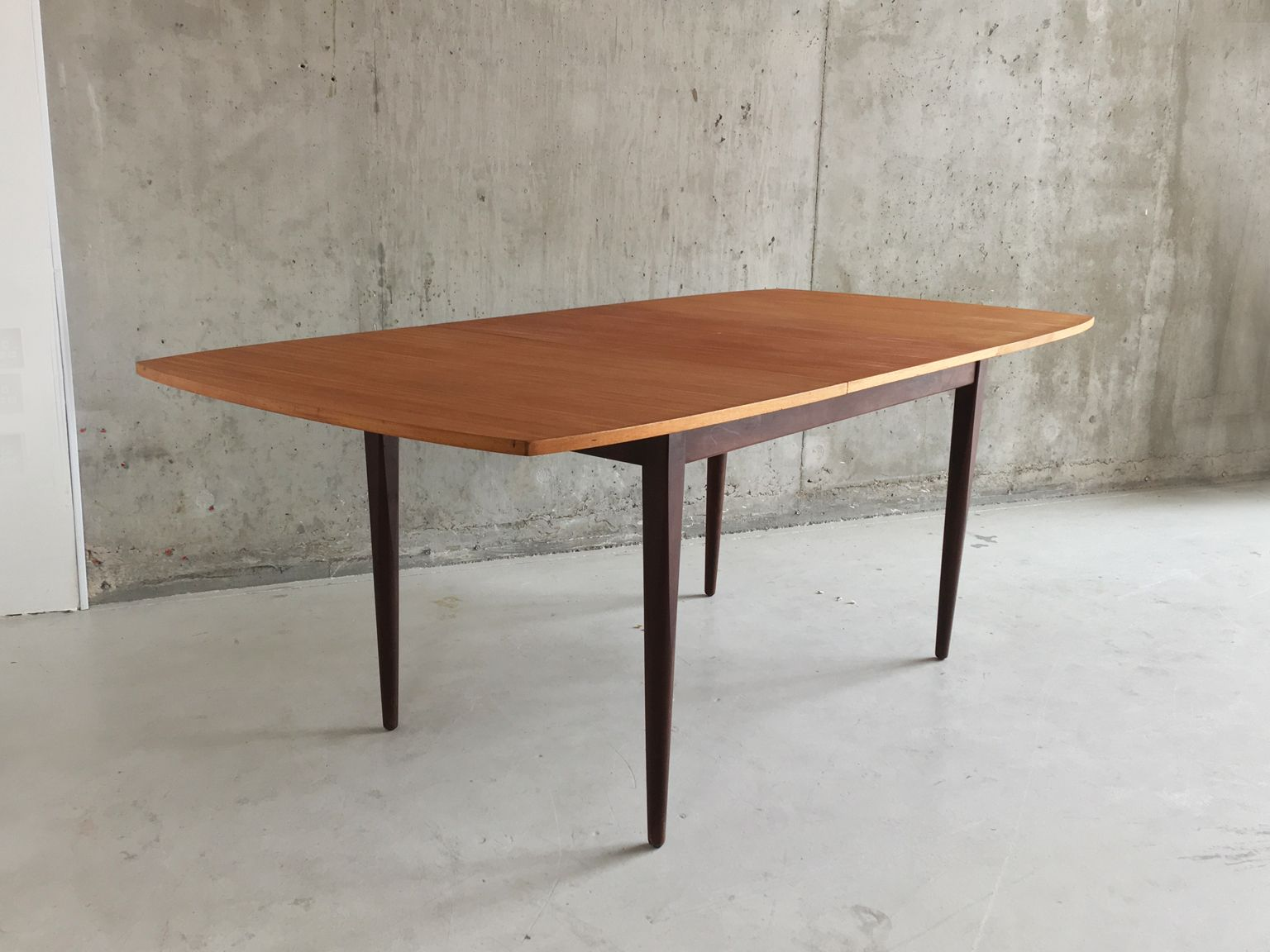 long english teak extendable table with tapered legs