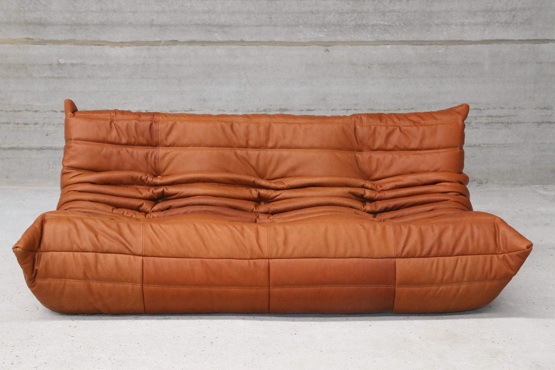 vintage togo cognac leather three seater sofa by michel ducaroy for ligne roset for sale at pamono. Black Bedroom Furniture Sets. Home Design Ideas