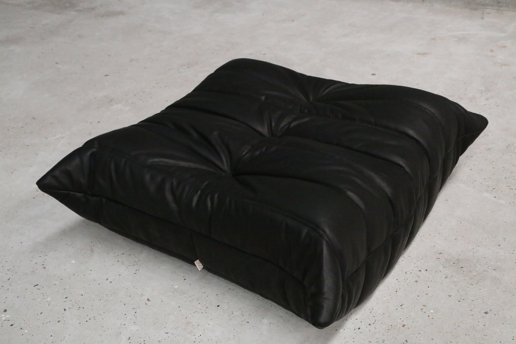 vintage one seater togo black leather sofa ottoman by. Black Bedroom Furniture Sets. Home Design Ideas