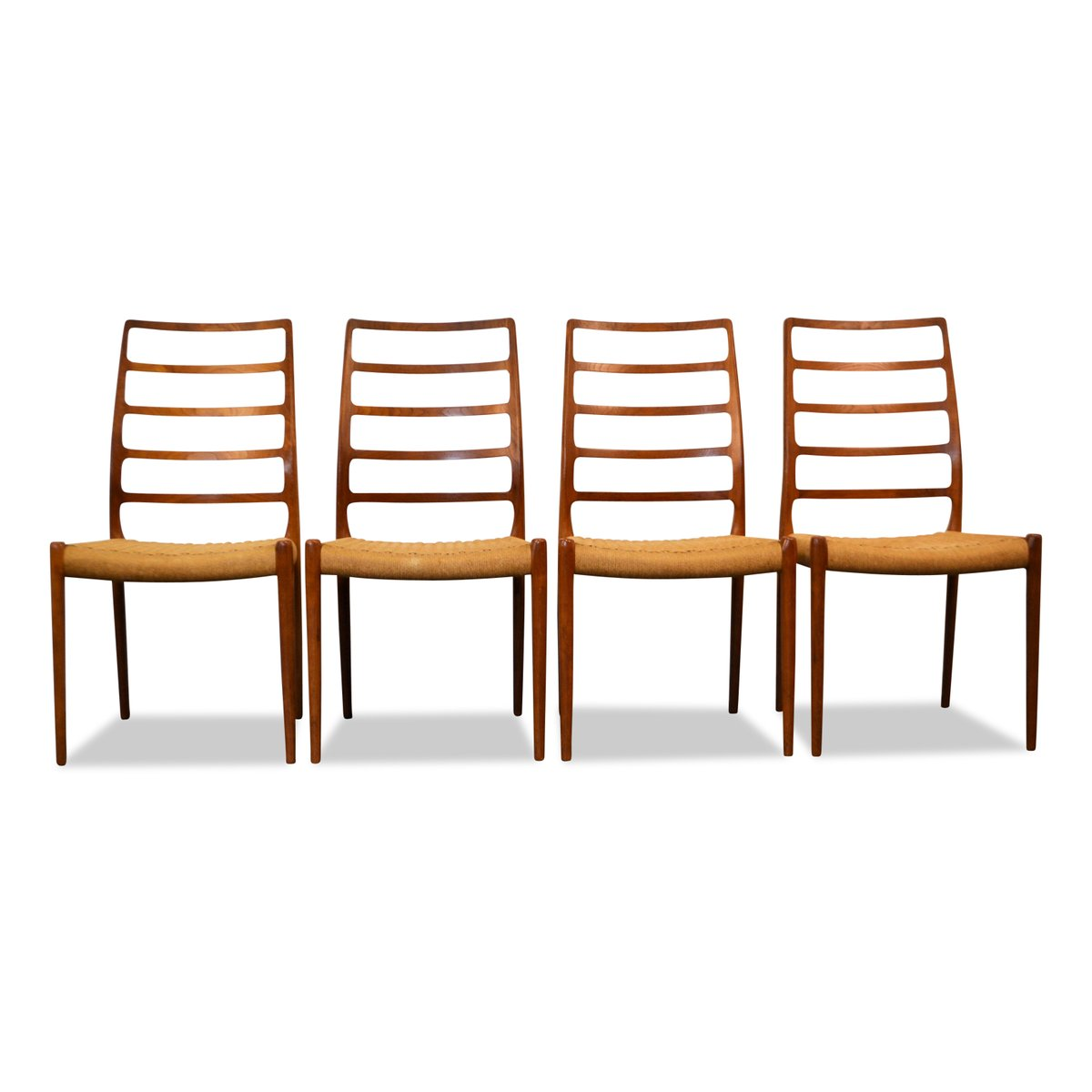 Vintage model teak dining chairs by niels o møller for