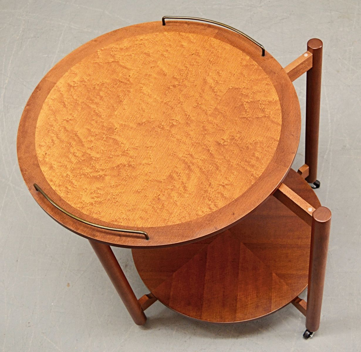 midcentury teak and birdseye maple circular drinks trolley
