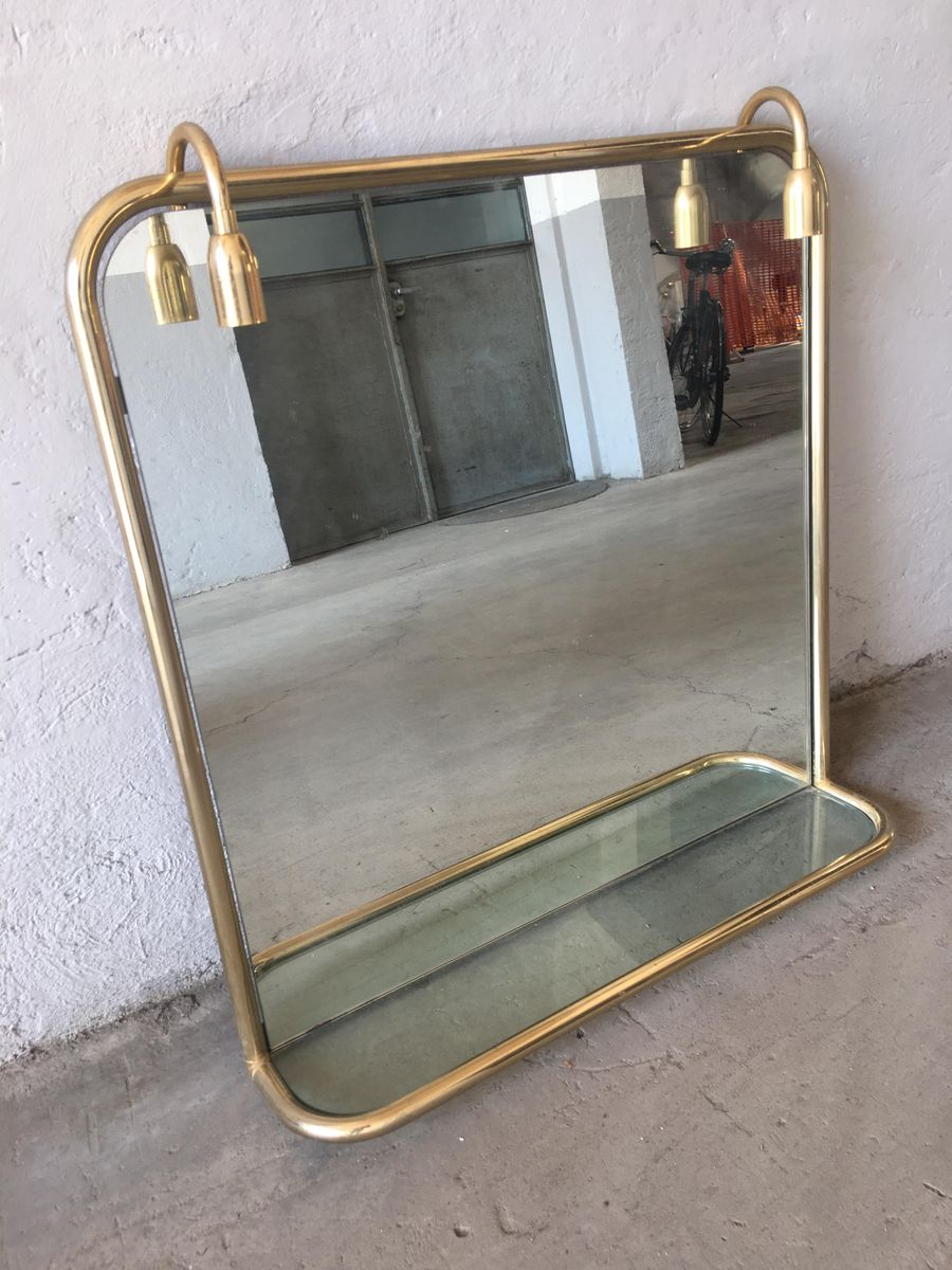 French gilt metal wall mirror with shelf and two lights for Mirror with shelf