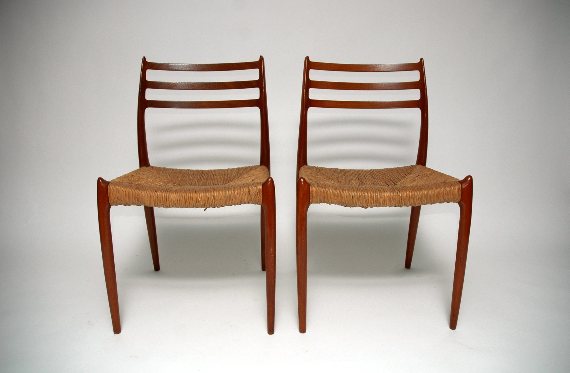 Mid century model dining chairs by niels o moller for