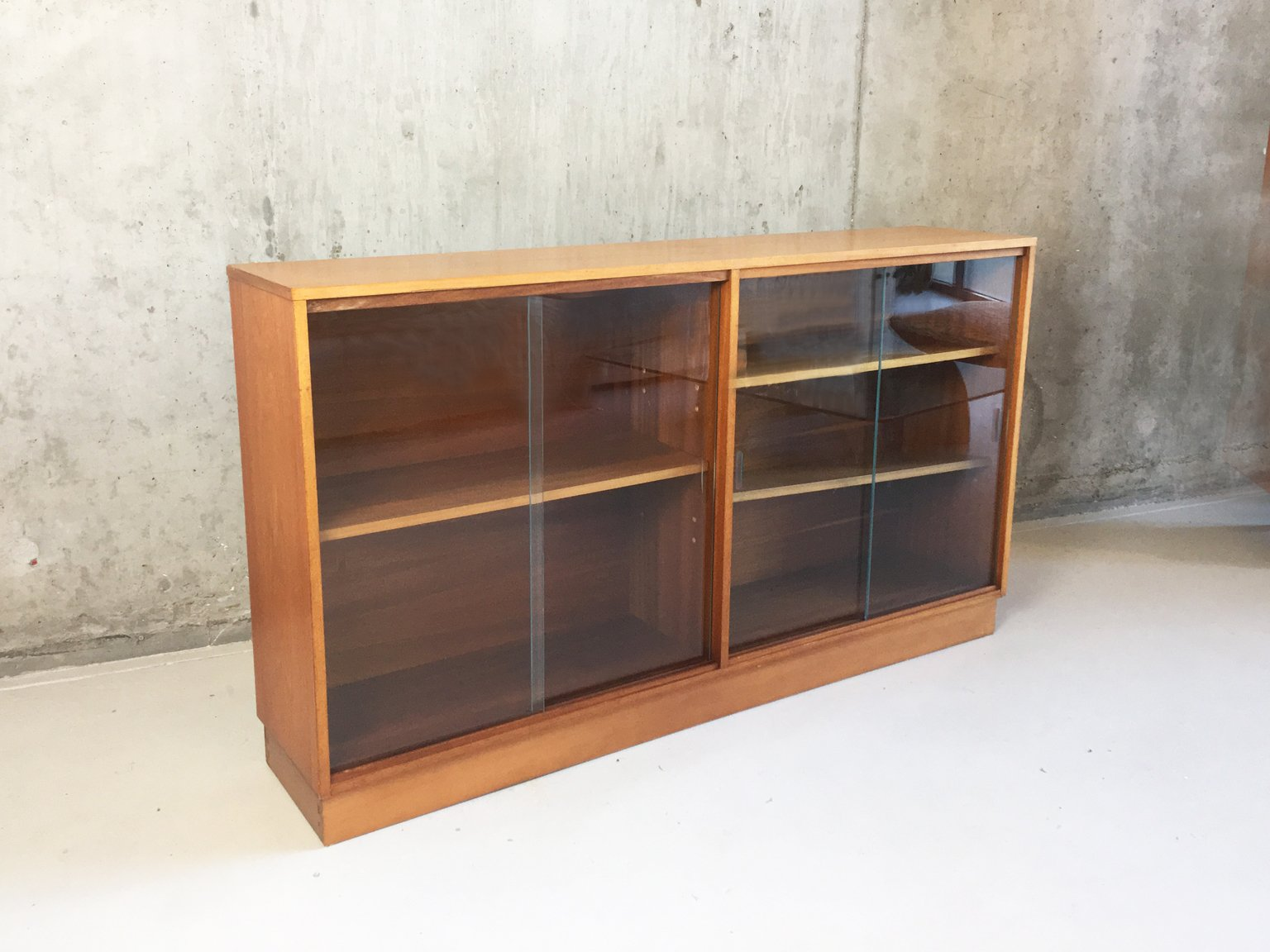 Long low beech bookcase with glass sliding doors from for Long sliding glass doors