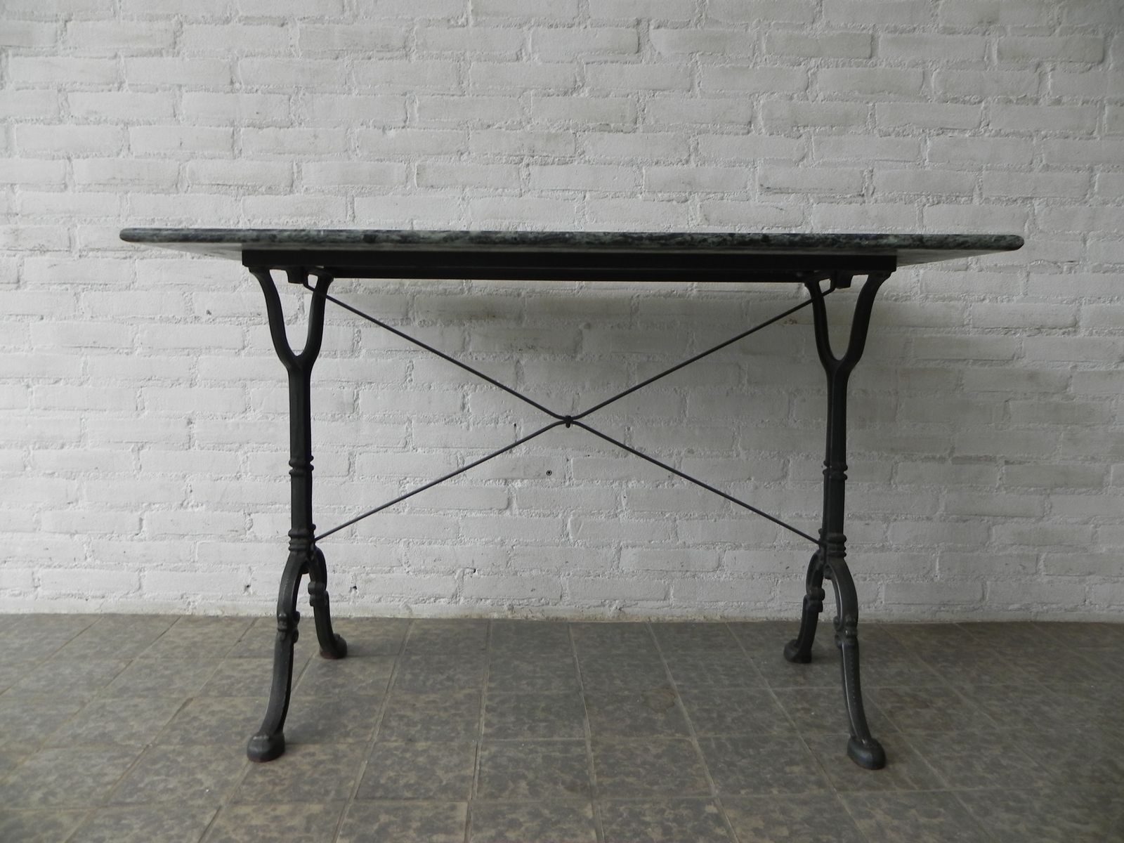 Garden table with cast iron base and marble top from godin for Cast iron table base marble top