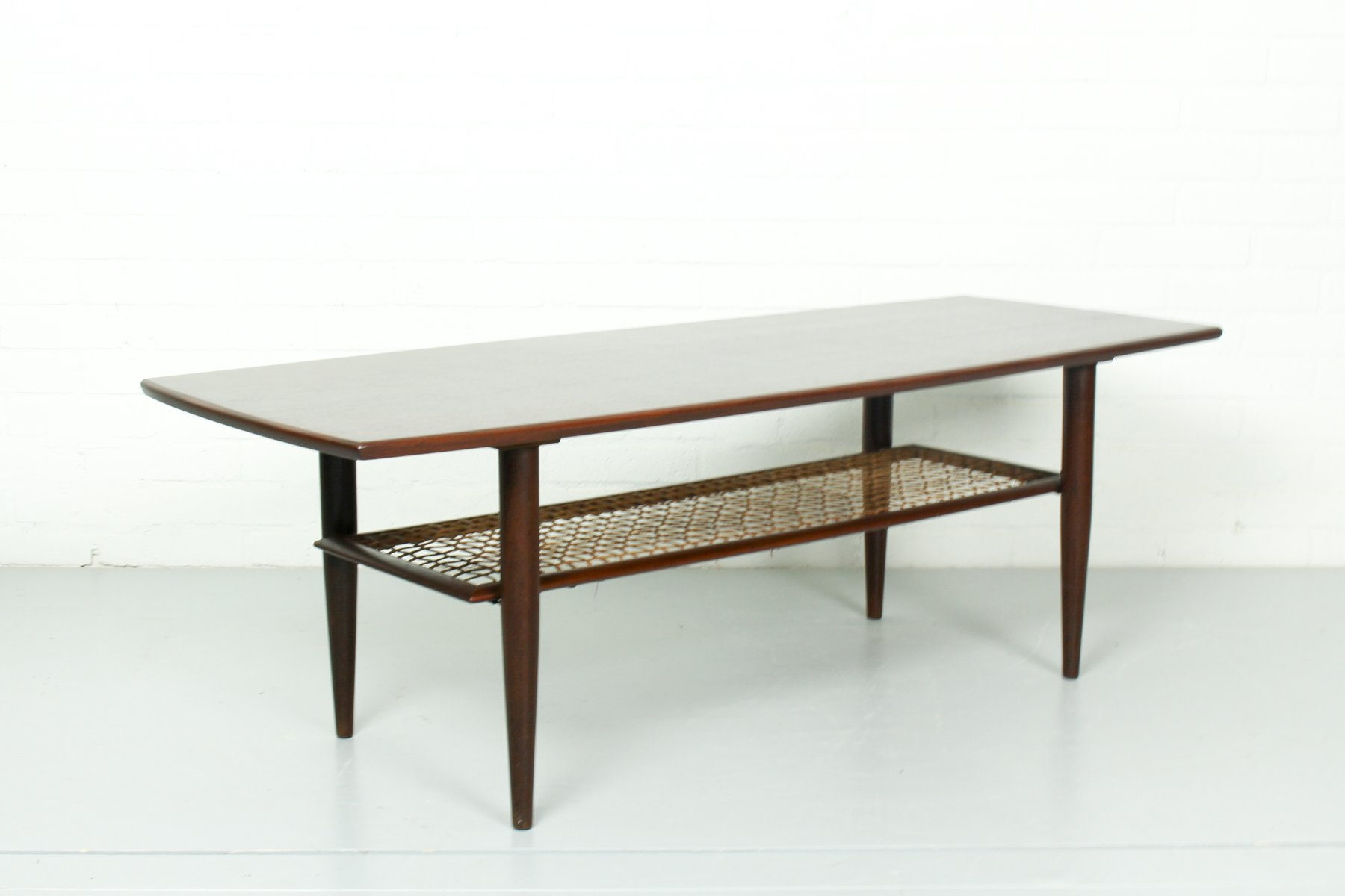 Vintage Teak Coffee Table with a Rattan Magazine Rack for sale at