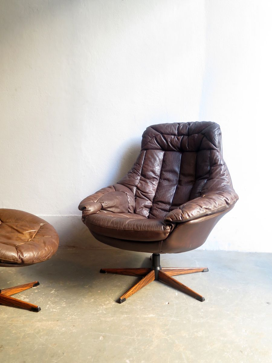 Vintage Leather Swivel Easy Chairs With Ottoman 6. $3,021.00. Price Per Set