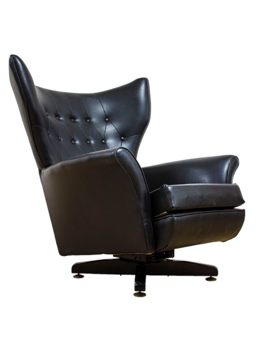 6250 Black Leather Wingbacked Blofeld Swivel Chair By Paul