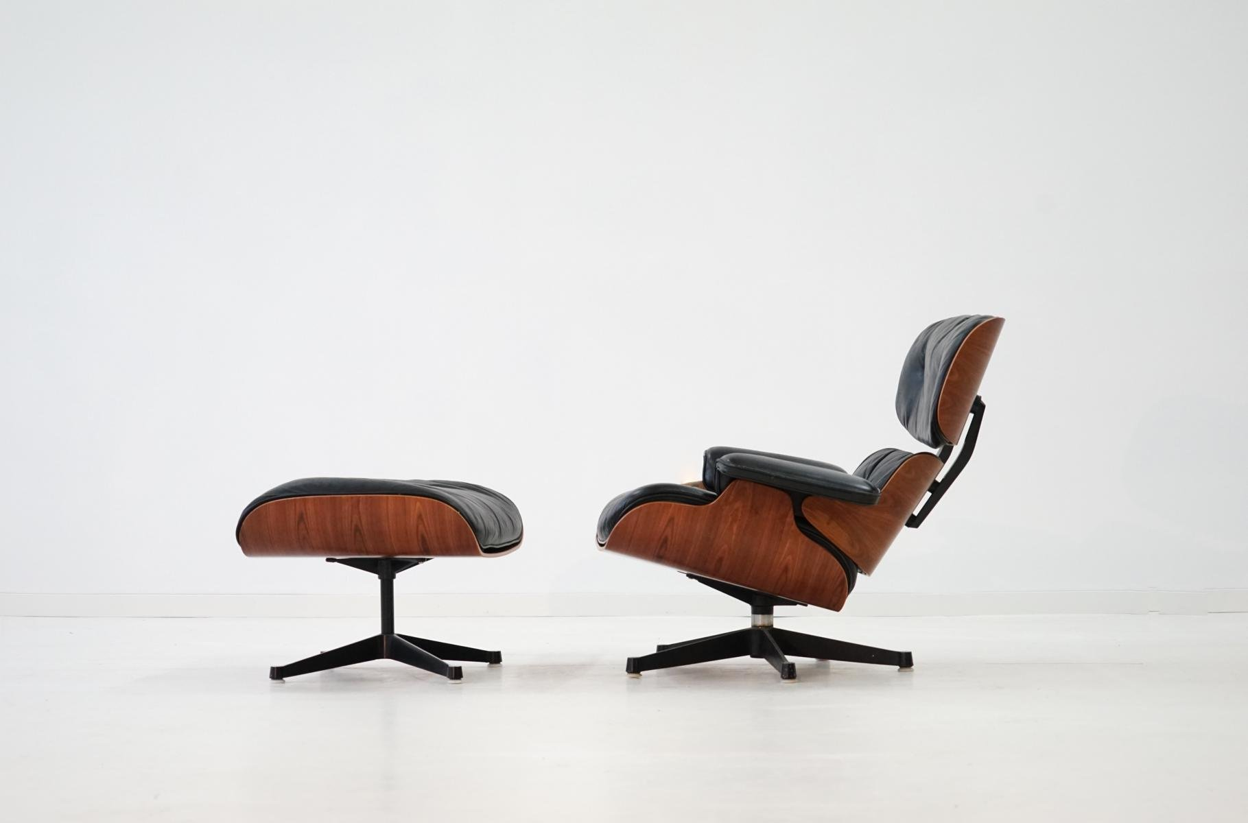Vintage Rosewood Lounge Chair & Ottoman by Charles & Ray Eames for