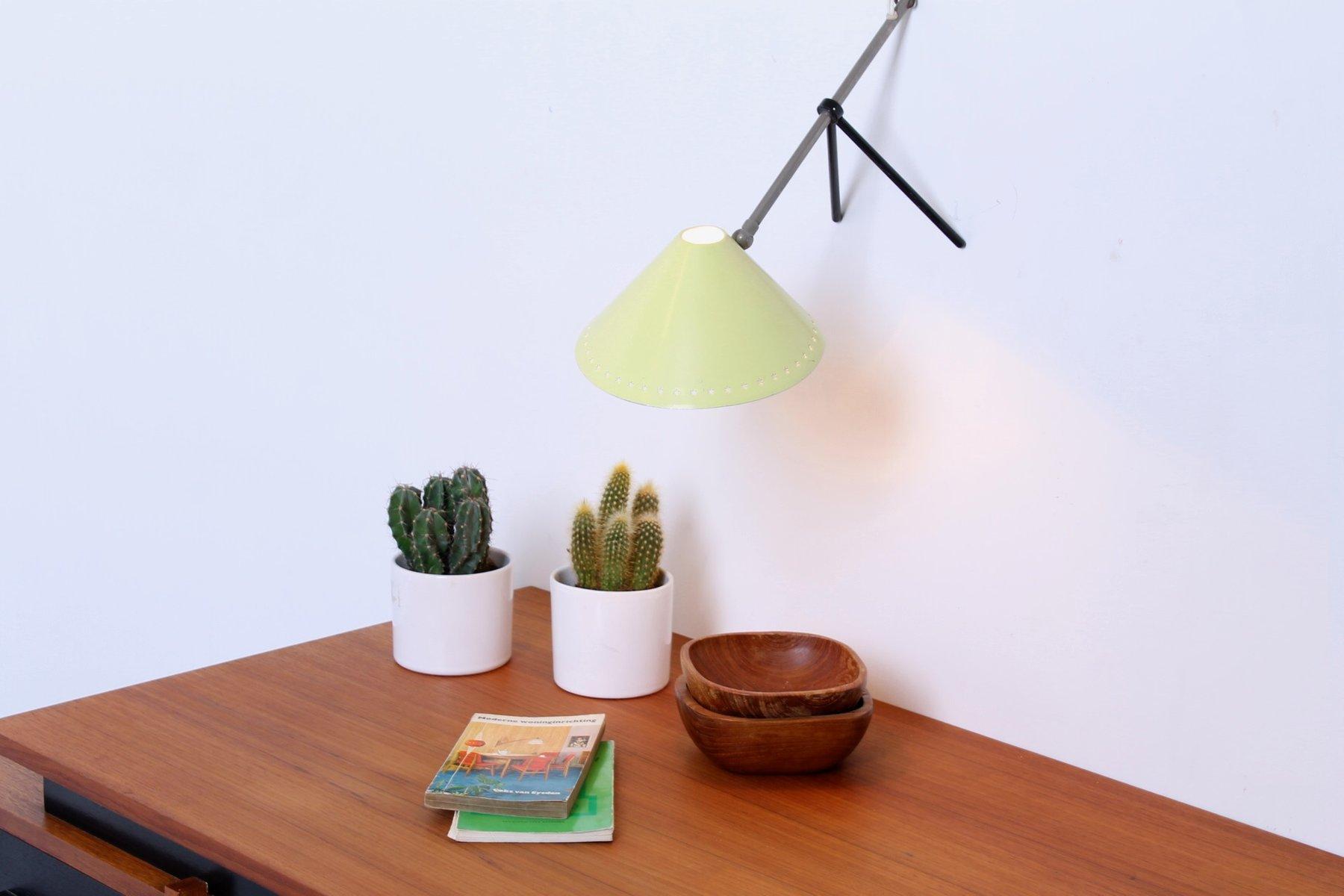 gelbe pinocchio tischlampe mit perforiertem schirm von. Black Bedroom Furniture Sets. Home Design Ideas