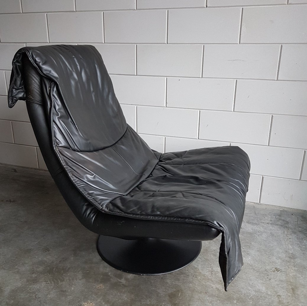 Vintage large black leather swivel lounge chair with for Swivel club chair leather