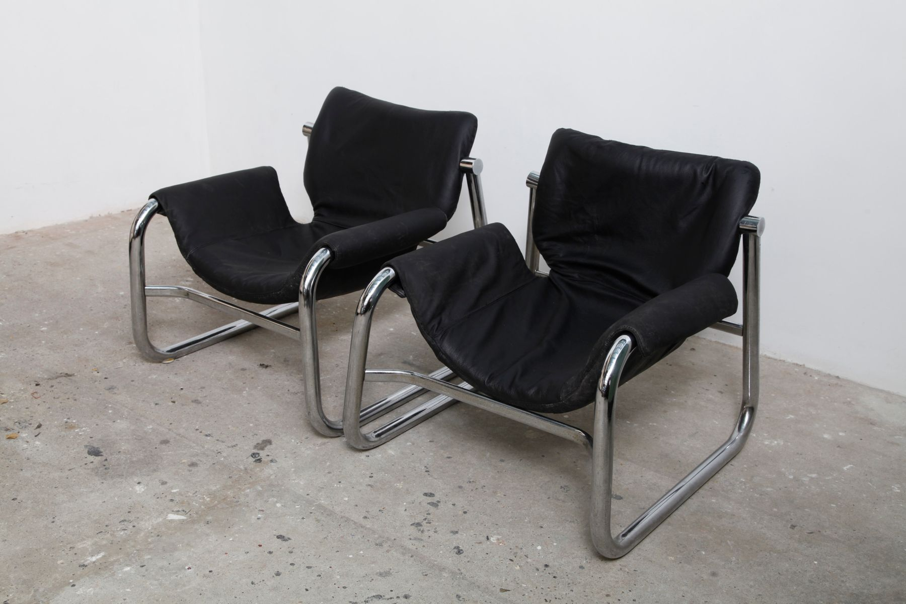 alpha chairs in chrome and leather by maurice burke 1968