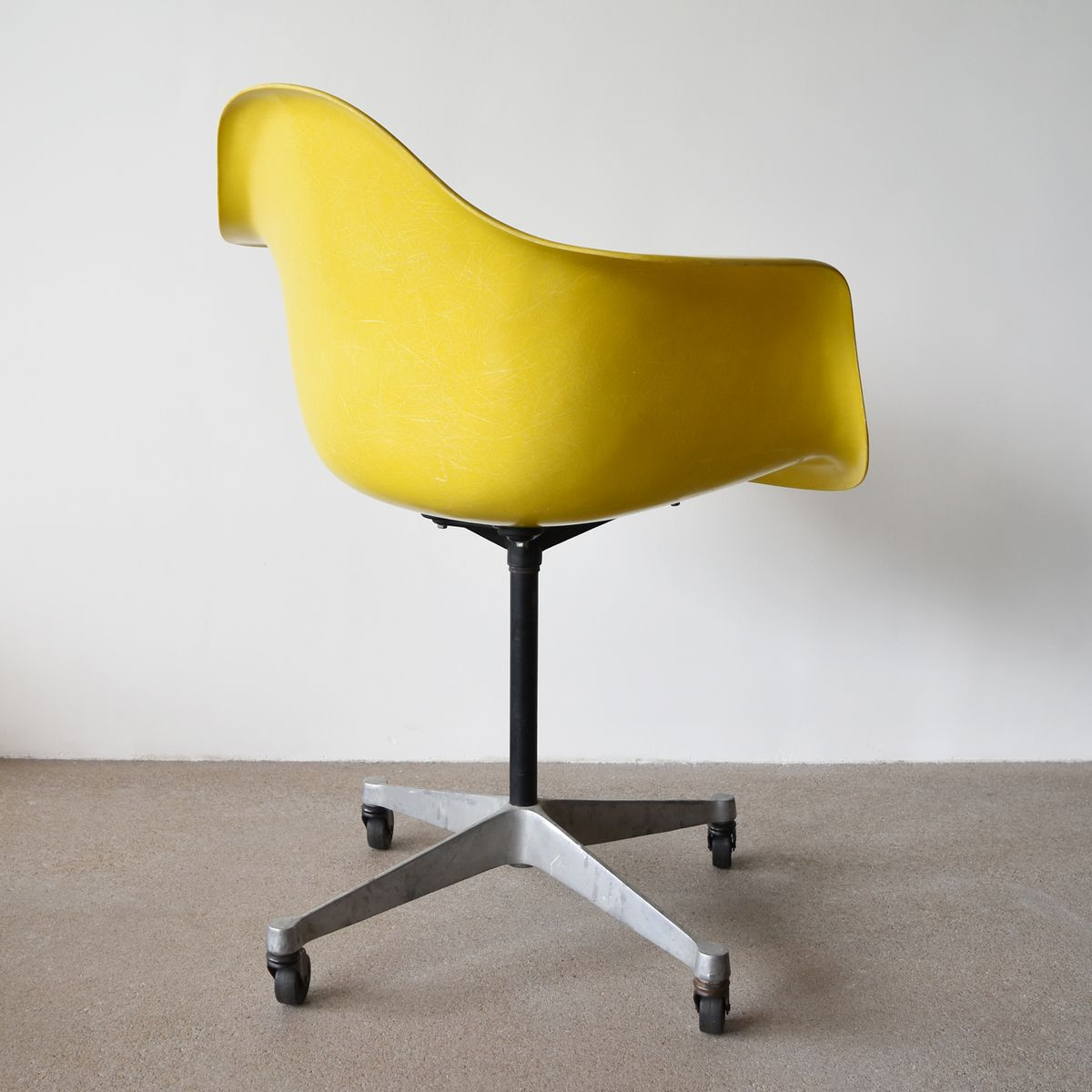 vintage pac chair in yellow by charles and ray eames for herman miller