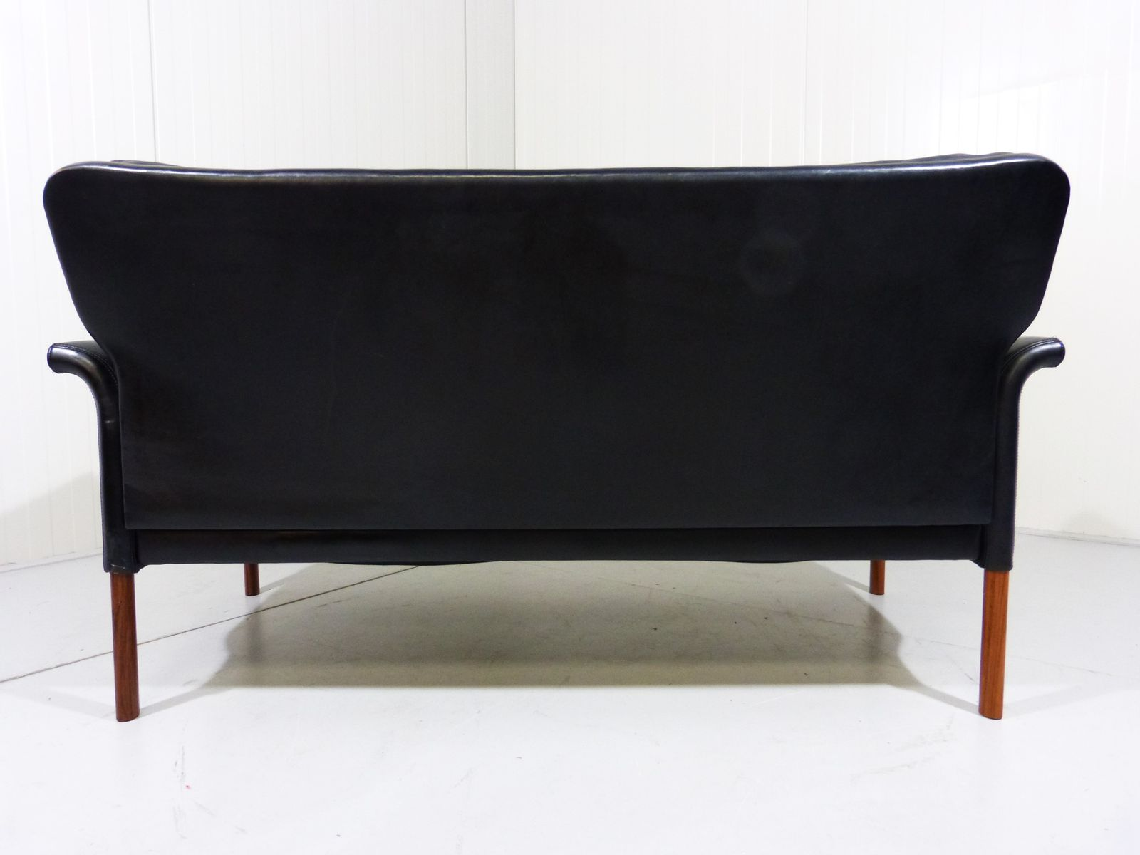 Vintage black leather and rosewood 2 seater sofa for sale for Leather sofa 7 seater