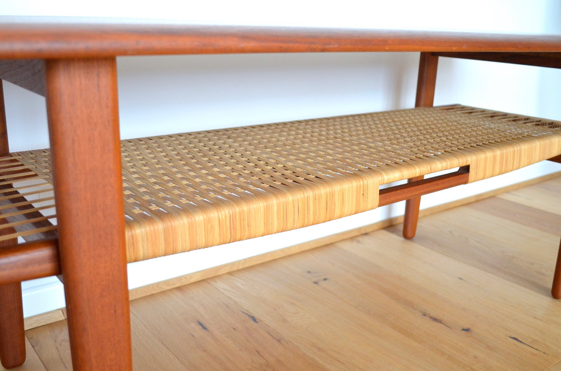 coffee table with rattan shelf by kurt
