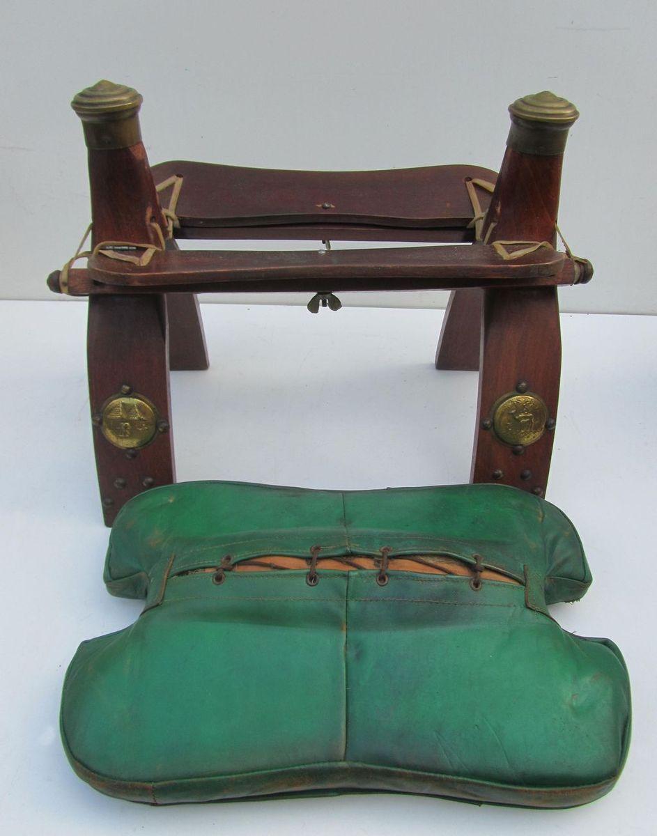 Vintage carved camel saddle ottomans set of for sale at