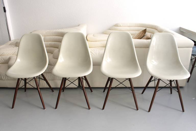 white fiberglass dsw chair by charles ray eames for herman miller