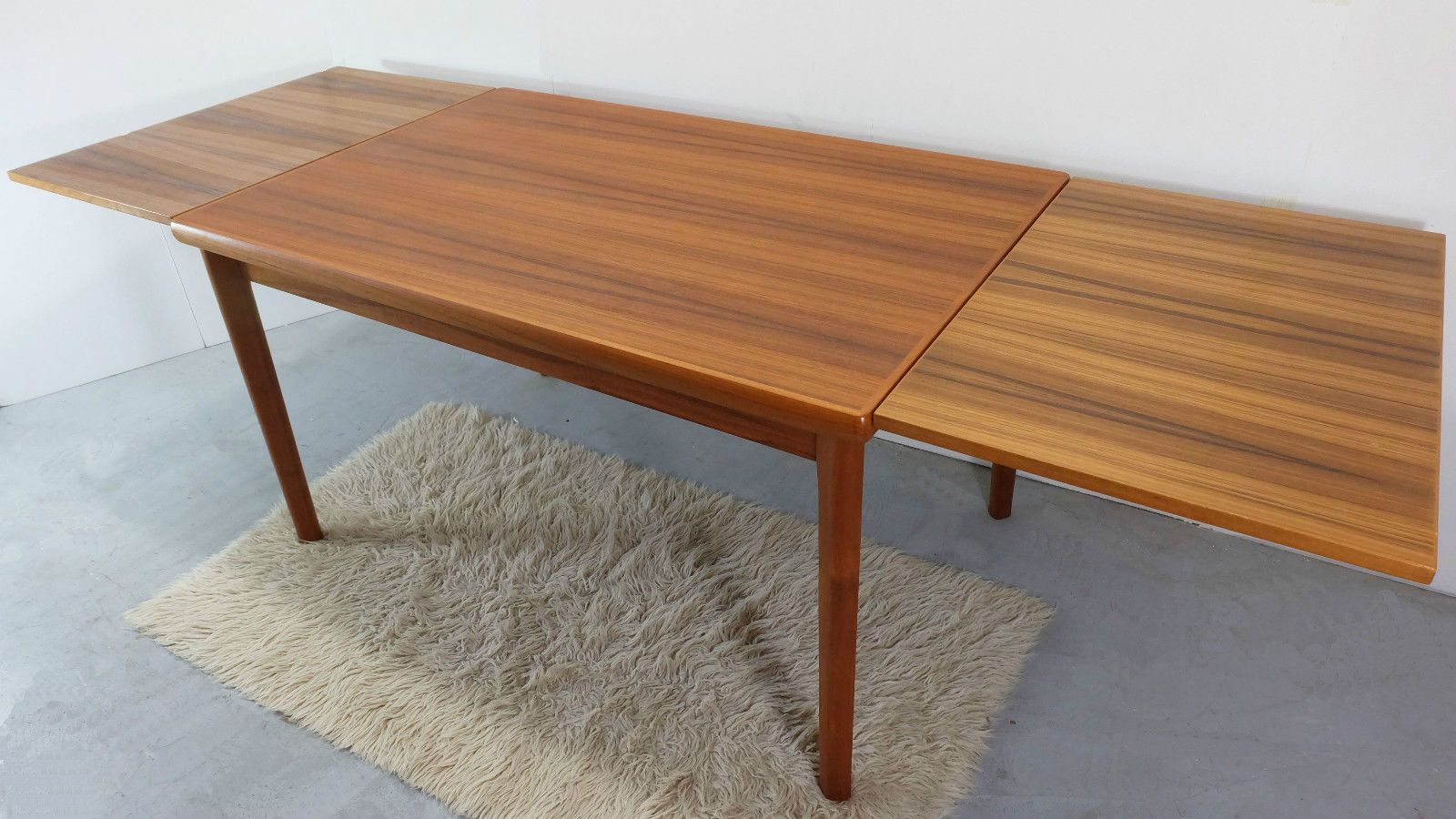 Danish teak dining table with two extension leaves 1970s for Dining table with two leaves
