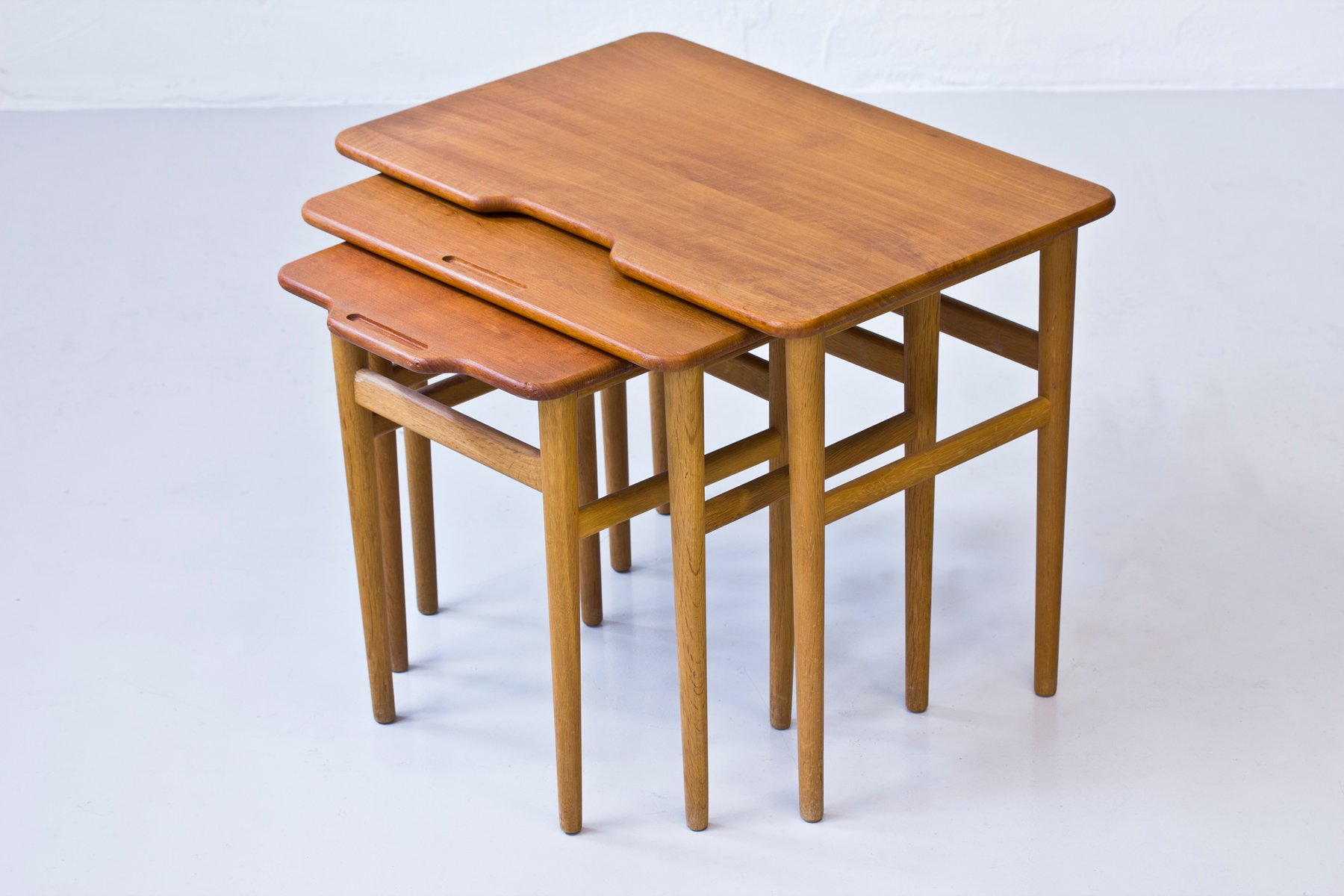 Vintage danish teak and oak nesting tables by kurt