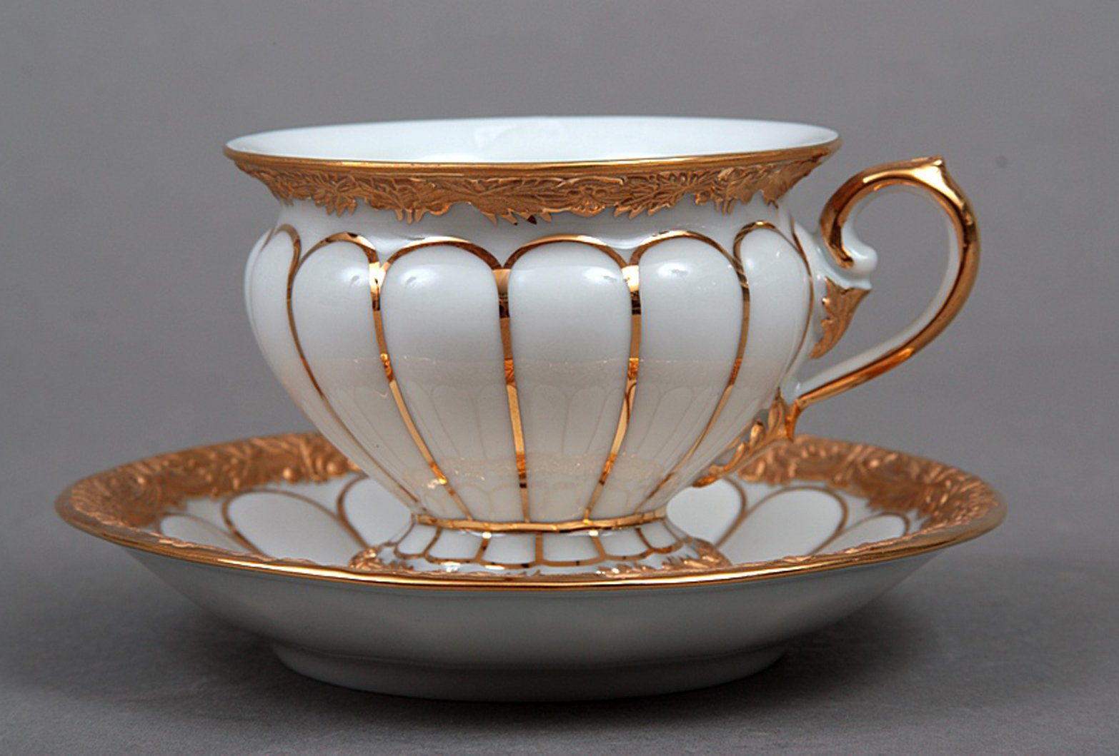 Meissen Porcelain Cup And Saucer With Golden Pattern For
