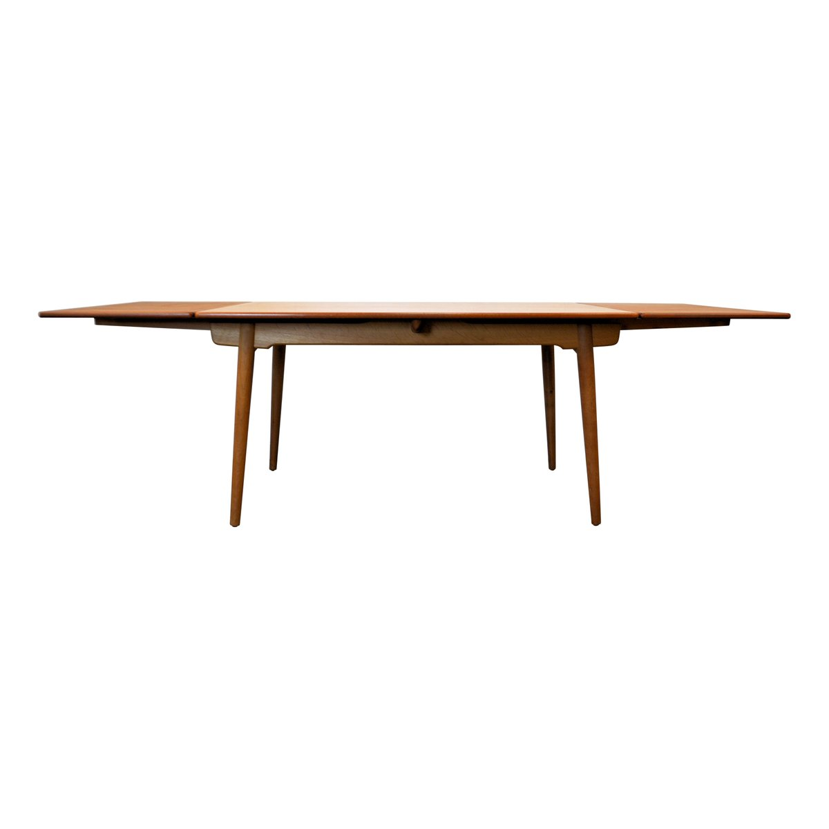 At 312 teak and oak extendable dining table by hans j for Extendable dining table