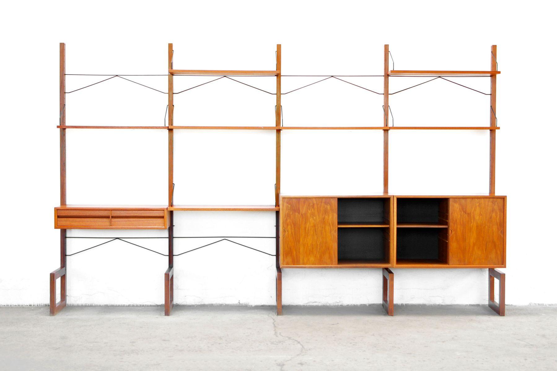 teak regalwand von poul cadovius 1958. Black Bedroom Furniture Sets. Home Design Ideas